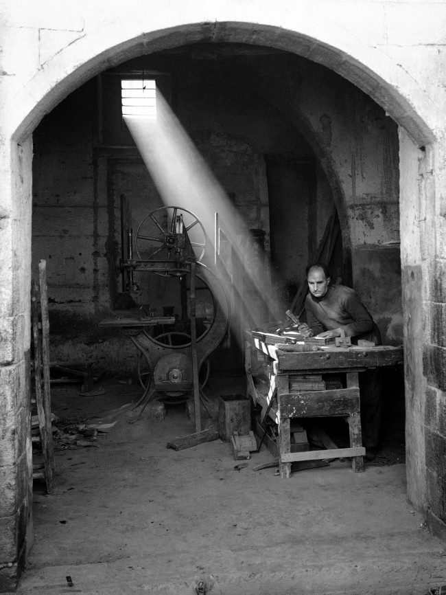 Skilled Syrian crafts man working by the light of the sun in an ancient shop in Damascus in December 1938. (AP Photo)