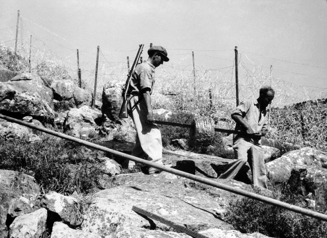 American Jewish colonists in Palestine completing the so called Tegart fence, on Aug. 23, 1938, which cost 500,000 dollars to build. It is 75 kilometres long, on the Palestine-Syria border, was suggested by Sir Charles Tegart, part of the British scheme to stamp out the Palestine disorders. (AP Photo)