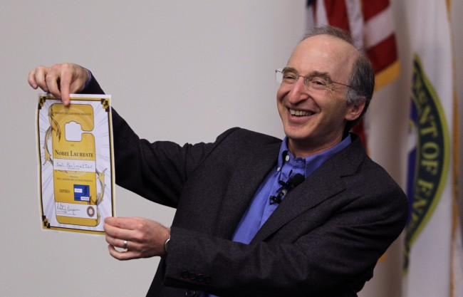 Nobel Prizes winner for physics astrophysicist Saul Perlmutter displays his lifetime parking pass good for parking at the University of California at Berkeley Tuesday, Oct. 4, 2011, in Berkeley, Calif. The Royal Swedish Academy of Sciences said American Perlmutter would share the 10 million kronor ($1.5 million) award with U.S.-Australian Brian Schmidt and U.S. scientist Adam Riess. Working in two separate research teams during the 1990s, Perlmutter in one and Schmidt and Riess in the other, the scientists raced to map the universe's expansion by analyzing a particular type of supernovas, or exploding stars. (AP Photo/Ben Margot)