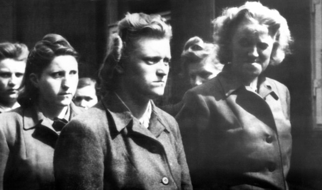 Some of the German S.S. women guards at the Belsen concentration camp who were captured after British troops entered the camp on April 15, 1945. The women guards were forced to help in the burial of thousands of victims. (AP Photo)