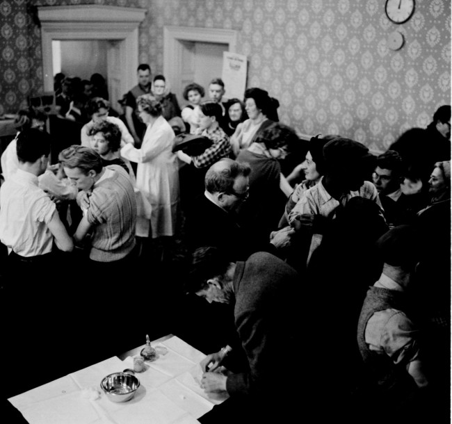 A smallpox outbreak was reported and had already claimed six lives. The busy scene as smallpox vaccinations were given in a special clinic at St. George's Hall, Bradford, Yorkshire. JANUARY 15TH, 1962. In Bradford, four people have the disease already and citizens have been flocking to clinics to safeguard themselves against smallpox.