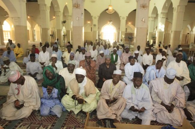 "Muslim men pray for peace and for people who lost their lives during the recent attacks, at a mosque in Kano, Nigeria, Monday, Jan. 23, 2012. The emir of Kano and the state's top politician offered prayers Monday along with local people for the more than 150 people who were killed in a coordinated series of attacks on Friday by the radical Islamist sect called Boko Haram which means ""Western education is sacrilege"" in the Hausa language of Nigeria's north.(AP Photo/Sunday Alamba)"