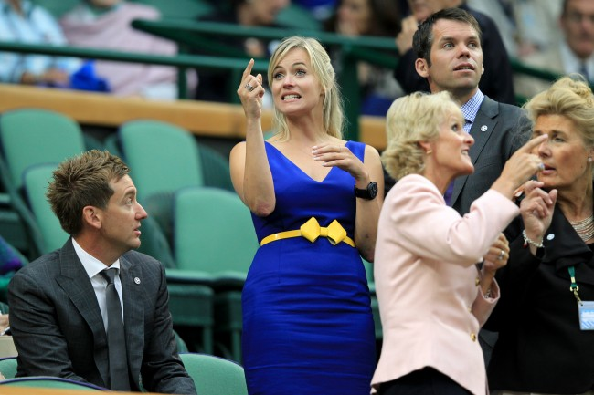 Golfers Ian Poulter (left) and Paul Casey (right) with the latter's partner Pollyanna Woodward in the Royal Box