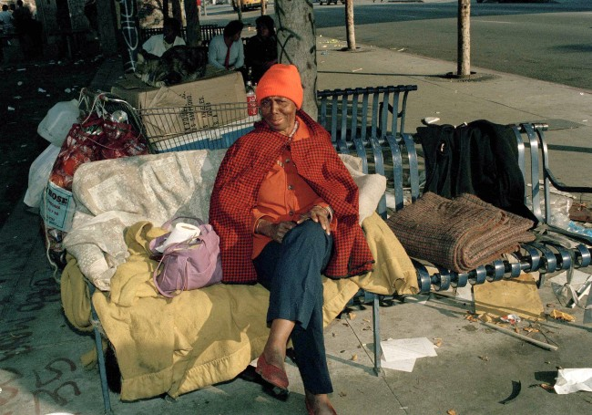 elen Oliver calls this bench in Los Angeles' skid row home, May 13, 1985. Oliver, her cat and three dogs has been living on a park bench in Justiceville, a shantytown that was bulldozed by the city. (AP Photo/Wally Fong)