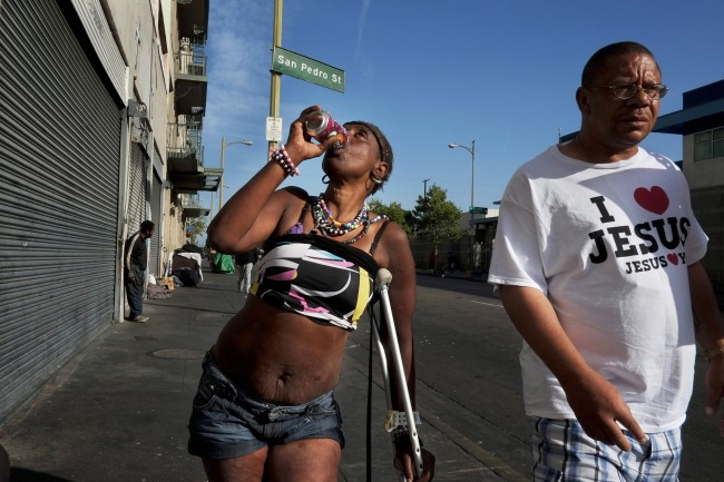 Antoinette Theus, 45, who says she has been homeless for 30 years, drinks a can of soda in the Skid Row area of Los Angeles, Thursday, April 11, 2013. (AP Photo/Jae C. Hong)