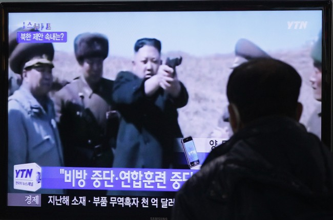 "A man watches a TV news program showing North Korean leader Kim Jong Un, at the Seoul Railway Station in Seoul, South Korea, Thursday, Jan. 16, 2014. North Korea's top government Thursday proposed the rival Koreas stop slandering each other from later this month, halt hostile military acts and work toward preventing a nuclear disaster on the divided peninsula. The letters read ""Stop slandering and joint military exercise"". (AP Photo/Ahn Young-joon)"