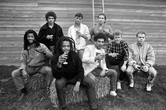 Pop group UB40 before rehearsals at Shepton Mallet for Channel 4's live rock show. Standing from left: Mickey Virtue, James Brown, Robin Campbell. Sitting from left: Earl Falconer, Astro, Norman Hassan, Brian Travers and Ali Campbell. Ref #: PA.1930686  Date: 23/09/1983