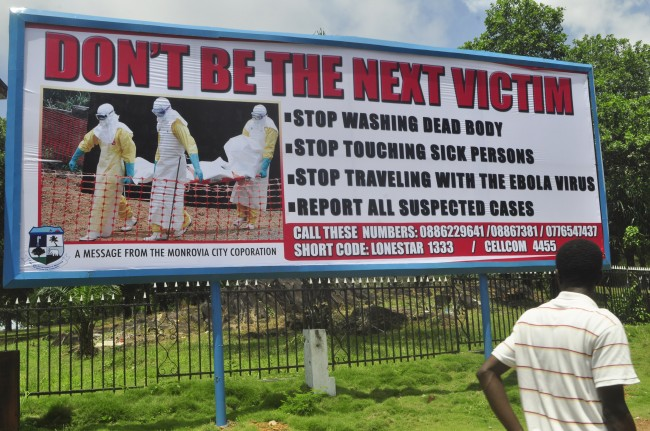 PA 21156576 Ebola: Sign Tells Liberians To Stop Washing Dead Bodies