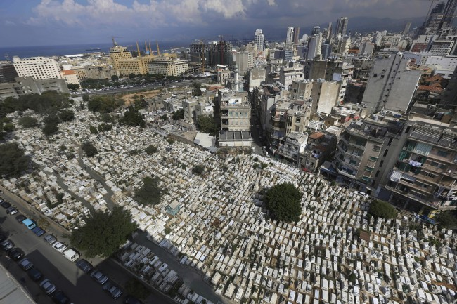 This Oct. 14, 2014, photo shows hundreds of graves at the overcrowded Bashoura cemetery for Muslim Sunnis in Beirut, Lebanon. The congested city of more than one million is cramped with cemeteries wedged into residential areas, increasingly forcing families to bury several members of the same family in one grave. Available land plots are extremely scarce and what is left is being used by developers to build luxury office towers and apartments. (AP Photo/Hussein Malla)
