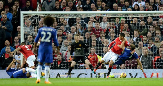 Manchester United's Chris Smalling wrestles with Chelsea's Branislav Ivanovic in the penalty area during the Barclays Premier League match at Old Trafford, Manchester.