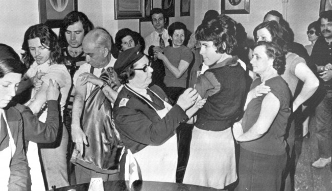 People queue up inside a health centre to have a smallpox inoculation, in Athens, Greece. Date: 19/04/1972