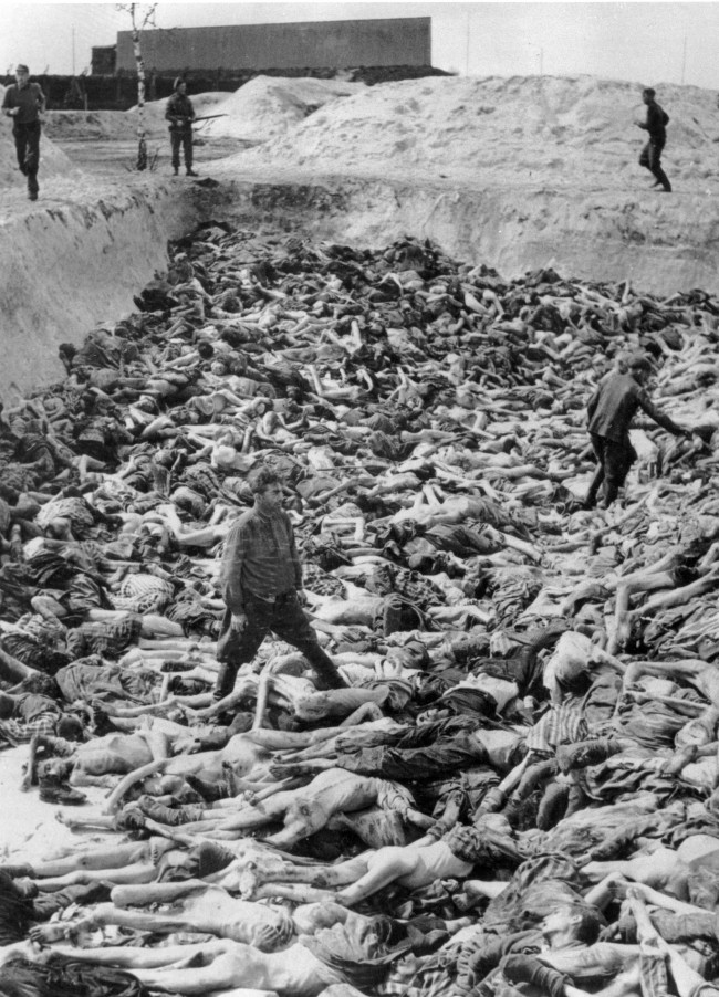 Dr. Fritz Klein, a Nazi officer, stands amongst victims of the Bergen-Belsen concentration camp on April 29, 1945. In the campground, under British supervision, are Nazis working to clean up the camp. (AP Photo)