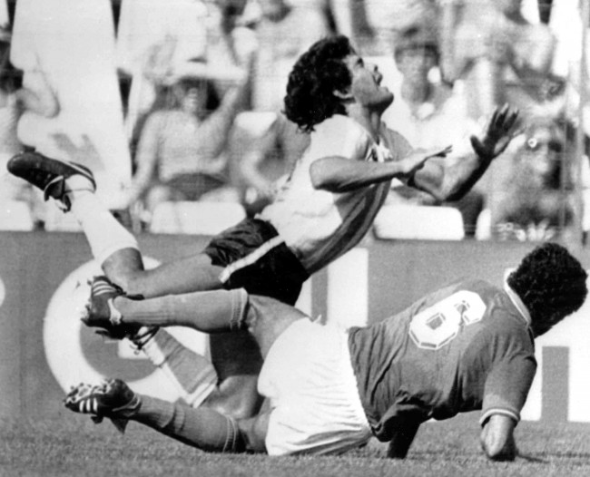 Argentina's Diego Maradona, is tackled by Italy's Claudio Gentile during the Soccer World Cup second round match, between Italy and Argentina, at the Sarra Stadium, Barcelona, June 29, 1982. Argentina defeated Italy 2 - 1. (AP Photo)