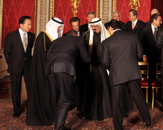 The President of the USA Barack Obama bows to King Abdullah of Saudi Arabia, before the official G20 photocall with the Queen at Buckingham Palace. Picture date: Wednesday April 1, 2009.