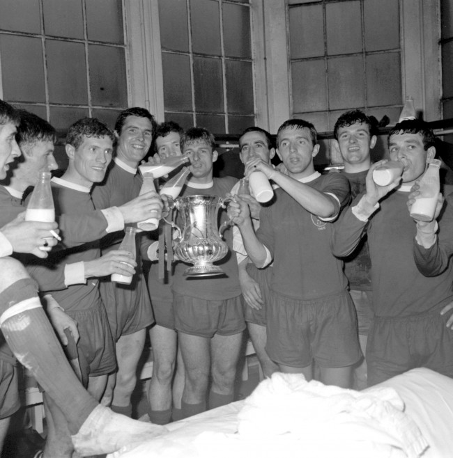 The Liverpool players celebrate with the FA Cup, and a bottle of milk each, in the dressing room after their 2-1 win: (l-r) Geoff Strong, Tommy Smith, Wilf Stevenson, Ron Yeats, Chris Lawler, Roger Hunt, Gerry Byrne, Peter Thompson, Tommy Lawrence, Ian Callaghan Date: 01/05/1965