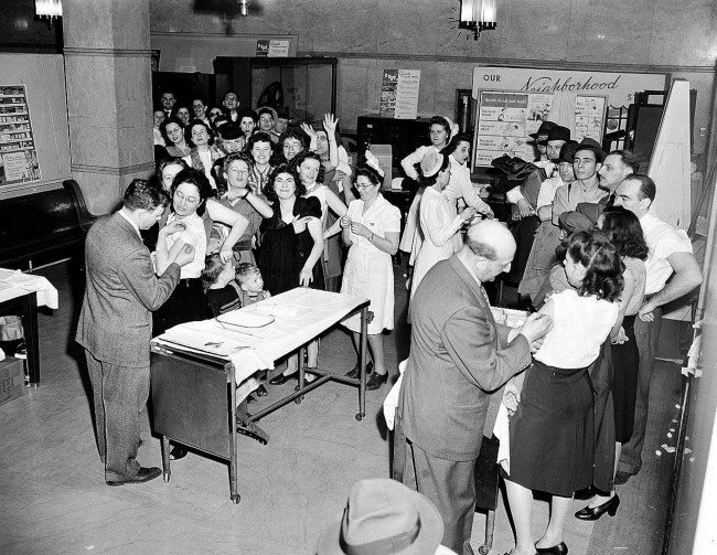 Dr. Walter X. Lehmann, left, and Dr. Kurt L. Brunsfeld, right, vaccinate two unidentifed women for smallpox April 14,1947, as others await their turn in New York City Health Department building. Crowds turned out after Health Commissioner Israel Weinstein's radio plea that the public be vaccinated. His plea came after nine cases, incuding two fatalities, were reported. (AP Photo/Tony Camerano)