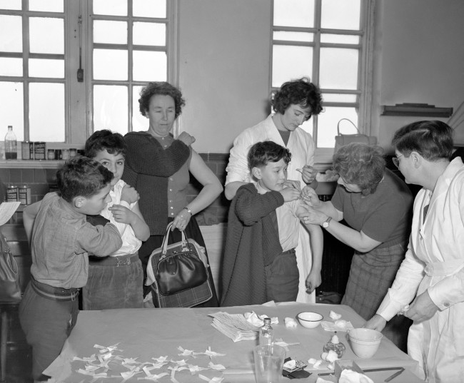 Ten year old Douglas Frame of Plumstead receives his vaccination against smallpox at Plumcroft Primary School. Date: 26/01/1962