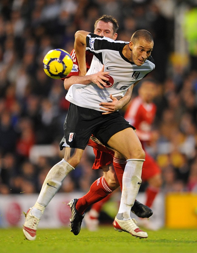 Liverpool's Jamie Carragher brings down Fulham's Bobby Zamora for which he receives a red card Ref #: PA.7982078