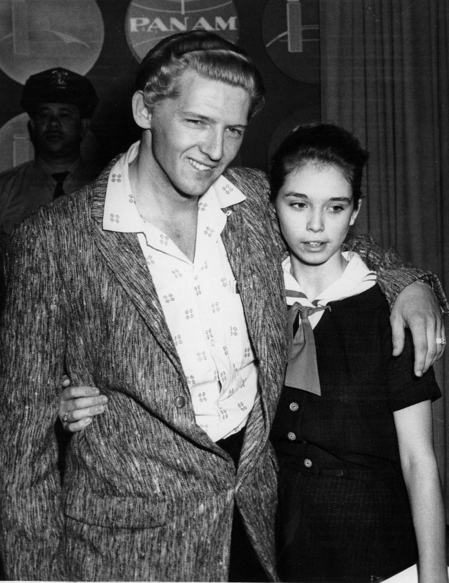 Seen at a London press conference on May 24, 1958 are American Rock 'n' Roll singer Jerry Lee Lewis, 22, and his cousin, Myra Brown, 13, whom he took as his third wife before divorcing his second. (AP Photo) Ref #: PA.8637867  Date: 24/05/1958