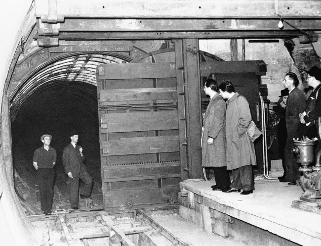 After viewing damage to Polish subways caused by German Air bombs, British have constructed great steel doors in the tunnels of London's tube railways, deep below the city, to prevent flooding caused by possible bomb damage to sewers, water mains and river culverts on Oct. 11, 1939. (AP Photo)