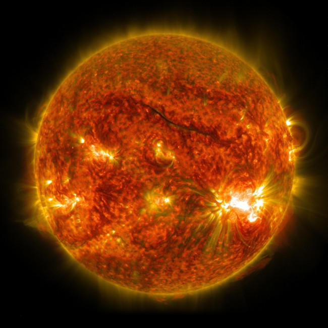 The bright light in the lower right region of the sun shows an X-class solar flare on Oct. 26, 2014, as captured by NASA's SDO. This was the third X-class flare in 48 hour. Image by NASA/SDO