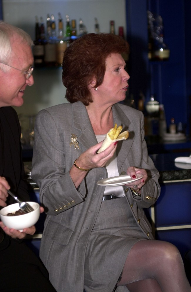 Native Merseysider Cilla Black tucks into a chip butty, a traditional Liverpudlian dish, during the first International Scouse Day at the Sugar Reef Restaurant in London. * International Scouse Day, which celebrates the achievements of Liverpudlians, is expected to raise thousands of pounds for the Alder Hey Rocking Horse Appeal.  Ref #: PA.1284761  Date: 29/03/2000