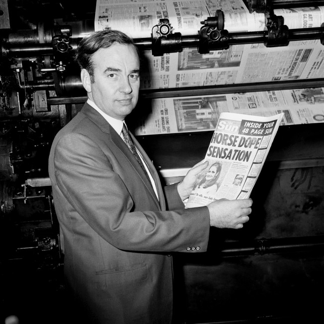 File picture, dated 17/11/1969, Rupert Murdoch looks at one of the first copies of The Sun newspaper, at the News of the World building , in London.