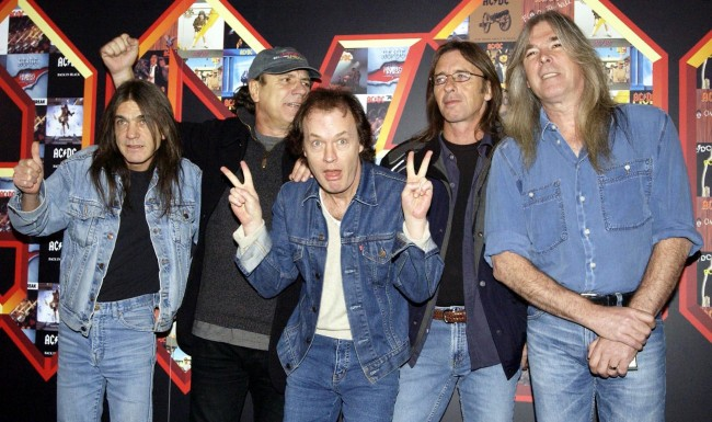 Rock group AC/DC, from left to right; Malcolm Young, Brian Johnson, Angus Young, Phil Rudd and Cliff Williams pose for photographers at Carling Apollo Hammersmith in London, during a photocall ahead of their concert at the same venue later tonight.  Ref #: PA.1817345  Date: 03/03/2003