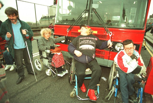 Disabled rights demonstrators chain themselves to a double decker bus on London's Westminster Bridge. The action coincided with a mass lobby of Parliament to demand that MP's support the latest Bill to give disabled people rights under the law.  Ref #: PA.1915871  Date: 09/02/1995