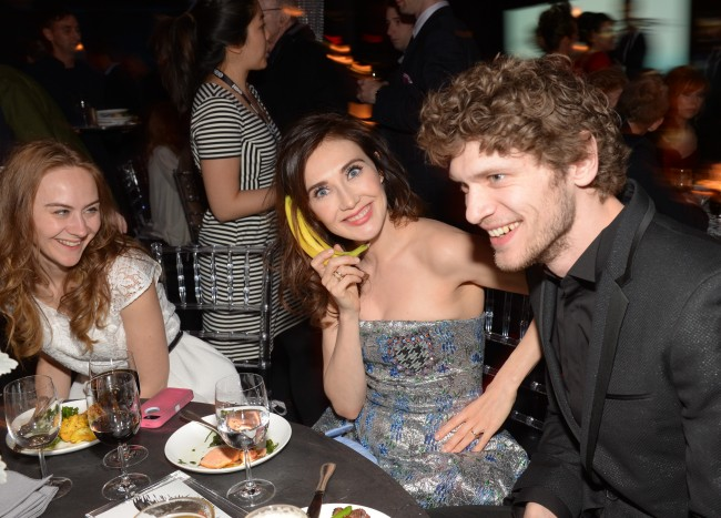 "Actress Carice van Houten, center, and friends attend HBO's ""Game of Thrones"" fourth season premiere after party at the Museum of Natural History on Tuesday, March 18, 2014 in New York. (Photo by Evan Agostini/Invision/AP)"