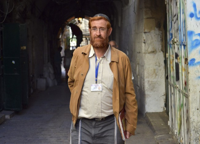 This photo made on Nov. 10, 2013 shows a hard-line Jewish activist Yehuda Glick walking in a street in Jerusalem. Late Wednesday, a gunman on a motorcycle shot and wounded Glick outside a conference promoting Jewish access to the site known to Jews as Temple Mount and to Muslims as Noble Sanctuary. (AP Photo/Mahmoud Illean)