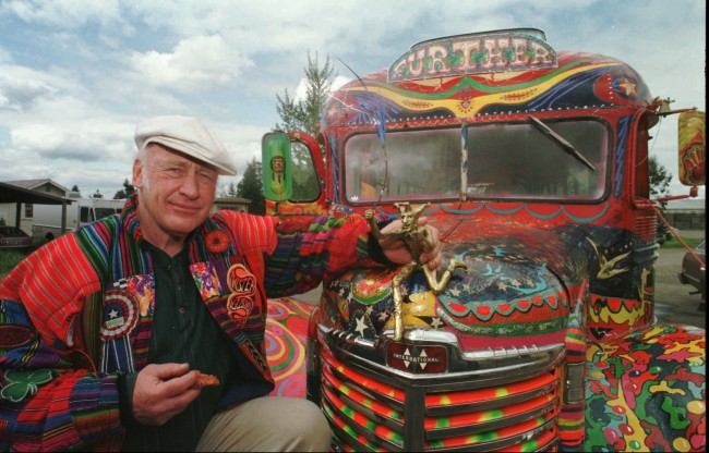 "Author Ken Kesey poses with the magic bus Further, a descendant of the vehicle that carried him and the Merry Pranksters on the 1964 trip immortalized in the Tom Wolfe book, ""The Electric Kool-Aid Acid Test.'' Kesey is taking the bus to the Rock and Roll Hall of Fame and Museum for an exhibit on the psychedelic 1960s."
