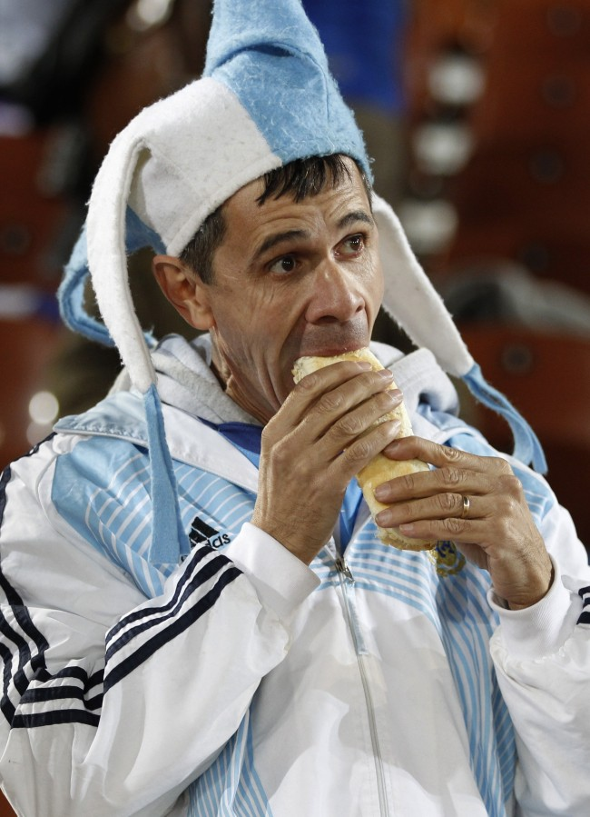 A fan of Argentina eats a sandwich prior to the during the World Cup group B soccer match between Greece and Argentina at Peter Mokaba Stadium in Polokwane, South Africa, Tuesday, June 22, 2010. (AP Photo/Ricardo Mazalan)