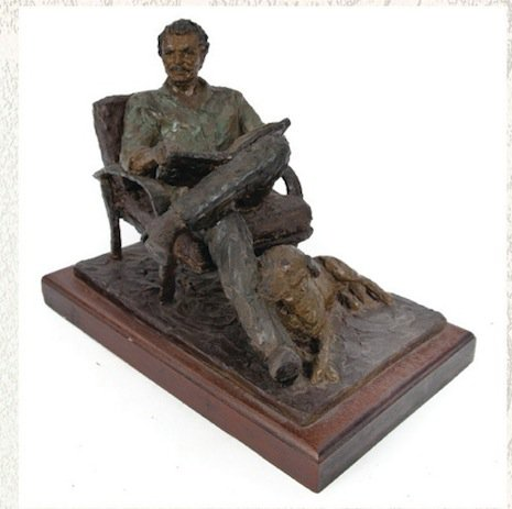 Sculpture of Reynolds reading a newspaper, opening bid $1000-2000
