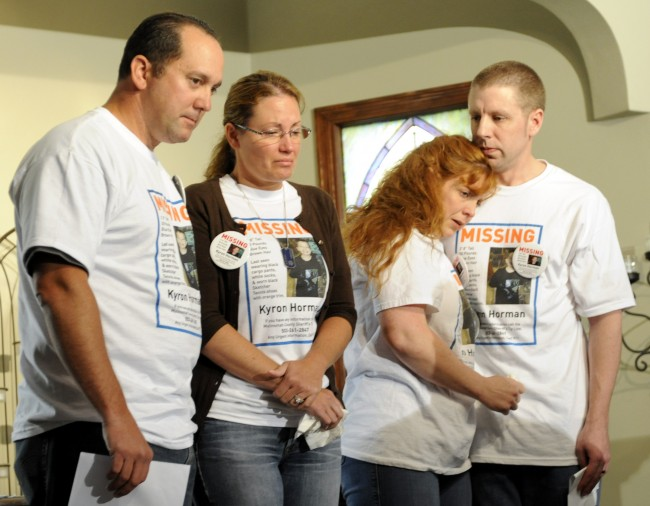 n this June 11, 2010 file photo, the family of missing 7-year-old Kyron Horman, from left, Tony Young, his mother Desiree Young, his stepmother Terri Horman and his father Kaine Horman stand together during a news conference, in Portland, Ore.