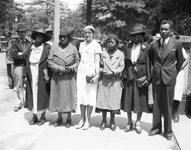 Mothers of the Scottsboro, Alabama, black youths condemned to death for an attack on two white women, vent to the White House on Mother's Day to ask for Presidential intervention. Four of them are pictured with Ruby Bates, one of the women alleged to have been attacked, by the black youths, and Richard B. Moore, black member of the Executive Committee Of The International Labor Defense. Left to Right: Ida Norris, Janie Patterson, Ruby Bates, Mamie Williams, Viola Montgomery , and Moore. A secretary informed the group that it was impossible for the President to receive the group or to intervene. ( AP Photo )