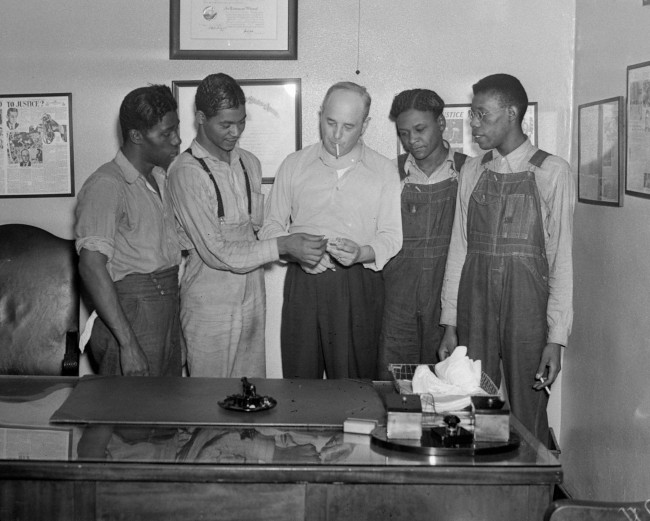 "In this July 26, 1937 file photo, New York attorney Samuel Leibowitz, center, stands in his office in New York with four of the ""Scottsboro Boys,"" from left, Willie Robertson, Eugene Williams, Roy Wright, and Olen Montgomery. Levin is credited with saving from death all but one of the nine black teens who were wrongly convicted of raping two white women in 1931. In a final chapter to one of the most important civil rights episodes in American history, Alabama lawmakers voted Thursday, April 4, 2013 to give posthumous pardons to the ""Scottsboro Boys"". (AP Photo, File)"