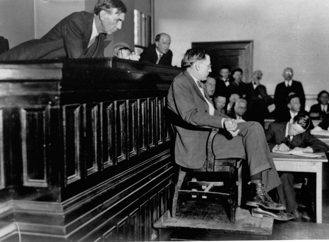 In this April 3, 1933 file photo, Judge James E. Horton leans over to listening to the testimony of Dr. R. R. Bridges, a Scottsboro, Ala. physician, in the Decatur, Ala. courtroom for the first of the retrials of eight of the nine Scottsboro black youths previously condemned to death for attacks on two white girls, Victoria Price and Ruby Bates. He said that he had found only superficial bruises and scratches when he examined Mrs. Price shortly after she was alleged to have been attacked aboard a train en route to Chattanooga. (AP Photo)