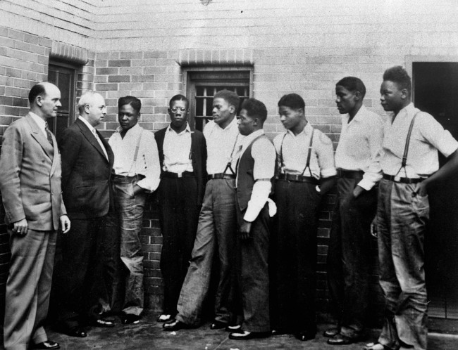 In this May 1, 1935 file photo, attorney Samuel Leibowitz from New York, second left, meets with seven of the Scottsboro defendants at the jail in Scottsboro, Ala. just after he asked the governor to pardon the nine youths held in the case. From left are Deputy Sheriff Charles McComb, Leibowitz, and defendants, Roy Wright, Olen Montgomery, Ozie Powell, Willie Robertson, Eugene Williams, Charlie Weems, and Andy Wright. The black youths were charged with an attack on two white women on March 25, 1931. (AP Photo)