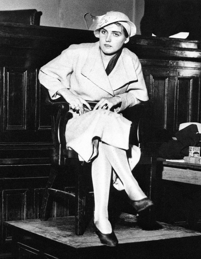 In this April 7, 1933 file photo, Ruby Bates sits in the witness stand in a courtroom in Decatur, Ala. Saying that Dr. Harry Emerson Fosdick had urged her to tell the truth, Bates denied that the nine black teenagers, known as the Scottsboro Boys, had assaulted her and her companion Victoria Price.