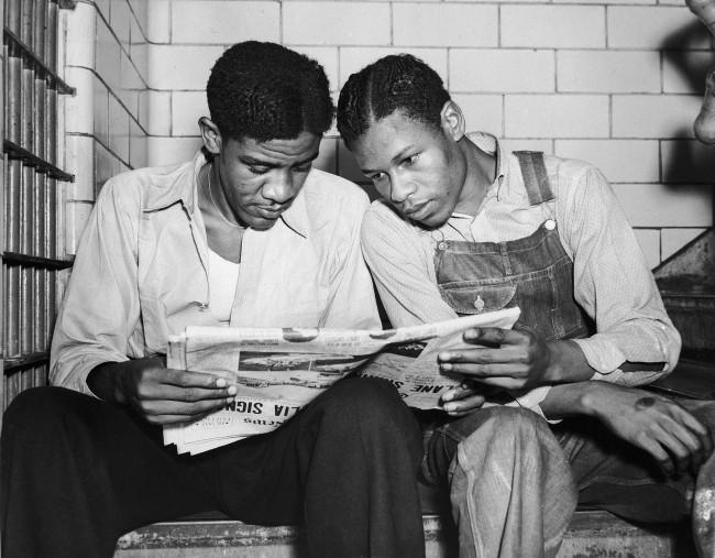 - In this July 16, 1937 file photo, Charlie Weems, left, and Clarence Norris, Scottsboro case defendants, read a newspaper in their Decatur, Ala. jail after Norris was found guilty for a third time by a jury which specified the death penalty. Weems was to be tried a week later.