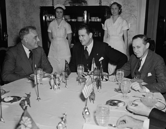 In this Dec. 5, 1939 file photo, President Franklin Roosevelt, left, talks to South Carolina Governor Olin Johnston at a breakfast in the mansion at Columbia, S.C. Leaving a judge to decide whether to throw out the conviction of 14-year-old George Stinney, who was executed in South Carolina in 1944, reminds his supporters of how the teen's fate was also in Johnston's hands nearly 70 years ago. Stinney's conviction is being challenged by a lawsuit filed by supporters asking for a new trial, a move unprecedented in South Carolina for someone already put to death. A hearing has been scheduled for Jan. 21, 2014. (AP File Photo)