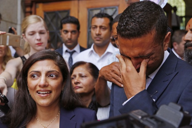 Ami Denborg, left, and her brother Anish Hindocha, right, react after the court case that acquitted their sister's former husband Shrien Dwani from murdering her at the high court in Cape Town, South Africa, Monday, Dec. 8, 2014. British man Shrien Dwani accused of killing his wife Anni while they were on honeymoon in Cape Town was acquitted of murder on Monday after a South African judge concluded that the prosecution's case did not have sufficient evidence. Shrien Dewani promptly descended stairs leading out of the courtroom following the not guilty ruling by Cape Town High Court Judge Jeanette Traverso. (AP Photo/Schalk van Zuydam)