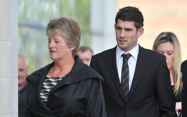 Sheffield United and Wales striker Ched Evans (centre) arrives at Caernafon Crown Court where he will stand trial today accused of raping a woman at a hotel. Picture date: Wednesday April 11, 2012.
