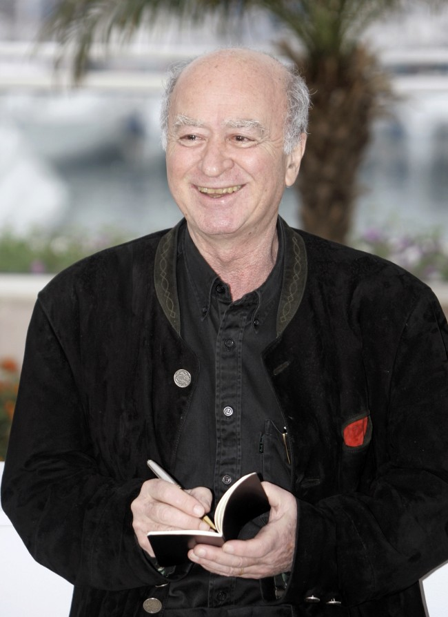 "this May 16, 2008 file photo, French cartoonist Georges Wolinski draws one of his cartoons at the photo call for the documentary film ""C'est Dur d'Etre Aime Par Des Cons,"" during the 61st International film festival in Cannes, southern France"