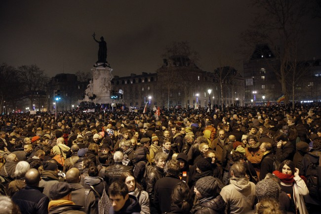 Demonstrators gather at the Place de la Republique after a shooting at a French satirical newspaper in Paris, France, Wednesday, Jan. 7, 2015.