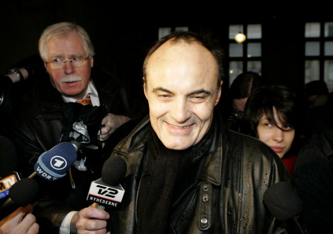 "Charlie-Hebdo director Philippe Val arrives at a Paris court, Wednesday Feb. 7, 2007 to face charges with ""publicly defaming a group of people because of their religion."" The charge carries a possible six-month prison sentence and a fine of up to euro 22,000 (US Dlrs 28,530). The French satirical weekly defended itself in court against defamation charges over reprinting caricatures of the Prophet Muhammad in 2006 which stoked outrage and violence across the Islamic world. T"