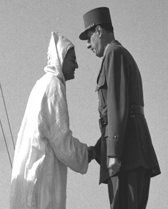 rance's Gen Charles De Gaulle, right, shakes hands with King Mohammed V, the Sultan of Morocco, at a ceremony at Place de la Concorde, Paris, June 18, 1945, to mark the anniversary of De Gaulle's first speech of June 18, 1940. De Gaulle and the Sultan took the salute from the French Army as soldiers marched past the reviewing stand. (AP Photo)