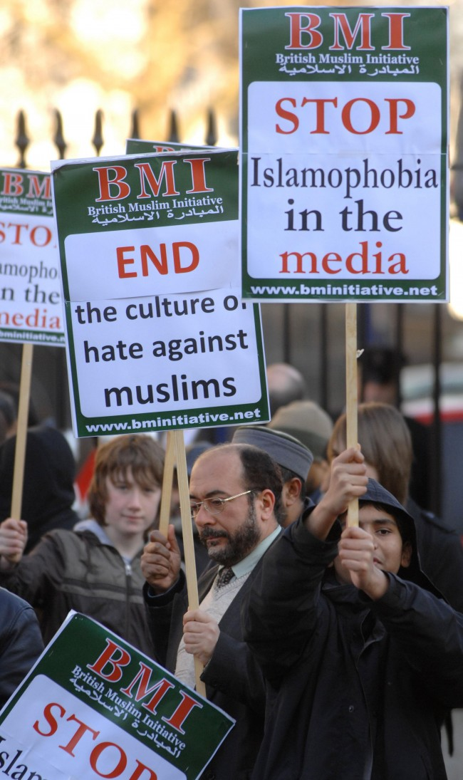 British Muslims hold a protest outside Downing Street demanding equal rights and an end of Islamophobia in the media. Picture date: Saturday February 16, 2008.