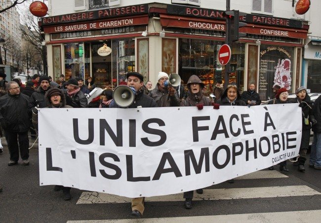 Demonstrators holding a banner which reads, 'unity against Islamophobia', to protest against the conference on the Islamization of France and Europe, in Paris, Saturday, Dec. 18, 2010.(AP Photo/Michel Euler)